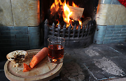 Embargoed to 0001 Saturday December 23 A mince pie, glass of sherry and a carrot for a reindeer is left by a fireplace. Lyme disease, gout and sleep deprivation are just a few of the health problems plaguing Saint Nick, the nation's leading GP has said.
