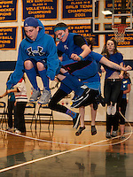 Branden Lemay and Alex Thornton sync their Freshman team during the long rope jump during Gilford High School's Winter Carnival games on Friday afternoon.  (Karen Bobotas/for the Laconia Daily Sun)
