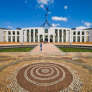 "The front of Parliament House, featuring an aboriginal tiled design on the ground. Parliament House is the meeting place of the Parliament of Australia. It is located in Canberra, the capital of Australia. It was opened on 9 May 1988 by Queen Elizabeth II, Queen of Australia.[1] Its construction cost was over $1.1 billion. At the time of its construction it was the most expensive building in the Southern Hemisphere. Prior to 1988, the Parliament of Australia met in the Provisional Parliament House, which is now known as ""Old Parliament House""."