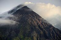 Clouds and smoke around the summit of Gunung Merapi, Kinahrejo, Java, Indonesia.
