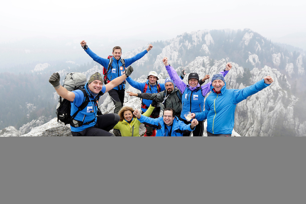 Via Dinarica team on the summit of Bijele Stijene, cks or cliffs in croatian), Velika Kapela mountain region, Croatia.  Behind them are celebrated Samarske Stijene ('stijene' means ro