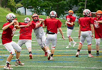 Under the concussion protocol the Laconia Sachems quarterback Kaleb Greenwood leads a practice play with non tackling drills on Thursday afternoon.   (Karen Bobotas/for the Laconia Daily Sun)