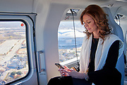 Charlotte Jones Anderson checks her email while on the helicopter between the stadium and airport in Dallas, Texas on December 12, 2017. (Cooper Neill for The New York Times)