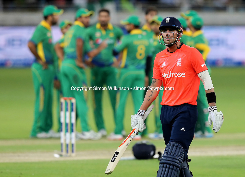 PICTURE BY MARK GREEN/SWPIX.COM  Pakistan v England 1st T20, Dubai Internayional Stadium, UAE, 26/11/15 <br /> England's Alex Hales walks as Pakistan celebrate. England were in trouble after losing their openers for 9 and 8.
