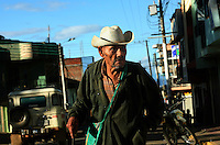 An elderly man walks down a street in Leiva, a small remote village in the southern Colombian state of Nariño, on Monday, June 25, 2007. (Photo/Scott Dalton)