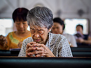 06 MARCH 2019 - BANGKOK, THAILAND: An elderly woman prays on Ash Wednesday at Holy Redeemer Catholic Church in Bangkok. There are about 300,000 Catholics in Thailand in about 430 Catholic parishes and about 660 Catholic priests in Thailand. Thais are tolerant of other religions and although Thailand is officially Buddhist, Catholics are allowed to freely practice and people who convert to Catholicism are not discriminated against.   PHOTO BY JACK KURTZ