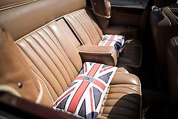 © Licensed to London News Pictures. 07/08/2016. Leeds UK. Picture shows the interior of a white convertible Rolls Royce Corniche 2 at the 37th Rolls Royce North rally that has taken place this weekend in the ground's of Harewood House in Yorkshire. The event bring's together some of the UK's most prized motor cars & their proud owners. Photo credit: Andrew McCaren/LNP