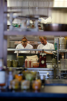 A chef preps ingredients for the dinner rush at The Block Restaurant in Webster Groves in St. Louis.