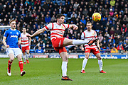Jordan Houghton (16) of Doncaster Rovers clears the ball during the EFL Sky Bet League 1 match between Portsmouth and Doncaster Rovers at Fratton Park, Portsmouth, England on 3 February 2018. Picture by Graham Hunt.