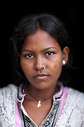 (name changed) Neelam Bharadwaj, 16, is standing inside her family's home in Rajbhar village, located around 20 kilometres away from Varanasi, in Uttar Pradesh, India. Neelam was raped when she was 13 years old. After walking to a local shop on the main road neighbouring her village, she was forcibly picked up by two men. While one of them was raping her in the bushes, the other watched out. After some time, she managed to free herself and run away, hiding under a bridge in cold dirty water for several hours. When she returned home in the morning, the family was too afraid to go to the police, but activist Mangla Parsad, 34, from PVCHR, convinced the family to take the right action. The police initially insulted and threatened the family for bringing the facts up, but filed the official case (FIR) nevertheless. The rape was not mentioned in the file due to an inaccurate and superficial medical record that did not, in fact, mention it. Because of social shame facing by victims of rape in India, the family agreed to wed Neelam to an older man, with help of an agent. After the marriage, her husband raped her again for a whole month before she decided to return home with her family. Neelam's father works in the metal industry in Mumbai and manages to send around 2-3000 INR every month. He only visits the family once in a year. Neelam goes to school and she is studying in 11th Class Standard. She is interested in doing BA in Arts after completing her high school 12th final year.