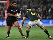 JOHANNESBURG, South Africa, 04 October 2014 : Charlie Faumuina of the All Blacks prepares to take the hit by Marcell Coetzee of the Springboks during the Castle Lager Rugby Championship test match between SOUTH AFRICA and NEW ZEALAND at ELLIS PARK in Johannesburg, South Africa on 04 October 2014. <br /> The Springboks won 27-25 but the All Blacks successfully defended the 2014 Championship trophy.<br /> <br /> © Anton de Villiers / SASPA