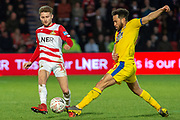 Doncaster Rovers forward Alfie May (19) is tackled by Crystal Palace midfielder Andros Townsend (10) during the The FA Cup 5th round match between Doncaster Rovers and Crystal Palace at the Keepmoat Stadium, Doncaster, England on 17 February 2019.