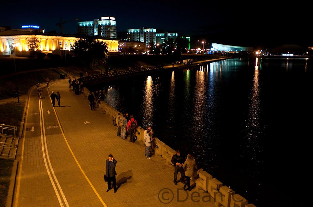 Minsk residents enjoy the boardwalk along the Svislach River in Minsk on Sept. 24, 2009.
