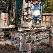 Latherer Crew making fabricating rebar for  pre drilled casson where steel beam will be place in the middle of the shoring pile. Concrete is then poured in for shoring pile base.<br />