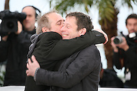 Director Arnaud Desplechin and actor Mathieu Amalric embrace at the Jimmy P. Psychotherapy of a Plains Indian film photocall at the Cannes Film Festival 18th May 2013
