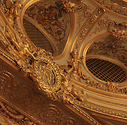 "Detail of grated boxes (loges grillées) located at the Gods or Paradise (paradis or poulailler in French), upper balcony, on the frieze of the floor appears the megaphone (porte-voix) with Napoleon's gilded coat of arms, Theatre Imperial Napoleon III de Fontainebleau (Fontainebleau Theatre Napoleon III), 1853-1856, by Hector Lefuel, Fontainebleau, Seine-et-Marne, France. Restoration of the theatre began in Spring 2013 thanks to an agreement between the Emirate of Abu Dhabi and the French Governement dedicating 5 M€ to the restoration.  In recognition of the sponsorship by the Emirate of Abu Dhabi, French Governement decided to rename the theatre as ""Theatre Cheikh Khalifa bin Zayed Al Nahyan"" (Cheikh Khalifa bin Zayed Al Nahyan Theatre). The achievement of the first stage of renovation has allowed the opening of the theatre to the public on May 3, 2014. Picture by Manuel Cohen"