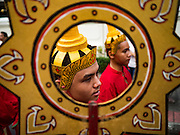 18 NOVEMBER 2015 - BANGKOK, THAILAND:  Young men in traditional Thai outfits in the procession marking the start of the temple's annual fair. Wat Saket is on a man-made hill in the historic section of Bangkok. The temple has golden spire that is 260 feet high which was the highest point in Bangkok for more than 100 years. The temple construction began in the 1800s in the reign of King Rama III and was completed in the reign of King Rama IV. The annual temple fair is held on the 12th lunar month, for nine days around the November full moon. During the fair a red cloth (reminiscent of a monk's robe) is placed around the Golden Mount while the temple grounds hosts Thai traditional theatre, food stalls and traditional shows.     PHOTO BY JACK KURTZ
