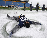 Winnipeg Blue Bombers' defensive back Darrell Pasco (22) makes a snow angel on the sidelines during practice at Canad Inns Stadium in Winnipeg, Friday, November 18th, 2011. The Bombers are preparing to face the Hamilton Tiger-Cats, Sunday in the East Final.