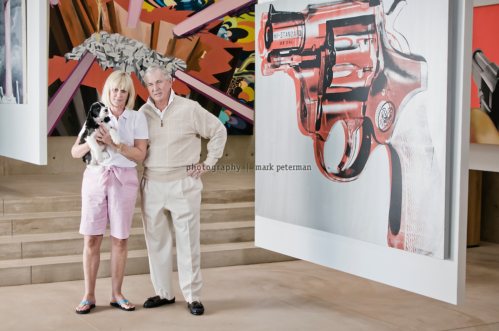 Scottsdale, AZ-Kent and VIcki Logan residence-03/03/11 Kent and Vicki Logan in the Entrance Gallery with Gun by Andy Warhol. Mark Peterman for The Wall Street Journal