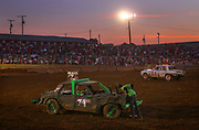 Arkansas Democrat-Gazette/BENJAMIN KRAIN --9/14/2013--<br /> A driver checks his engine condition as he enters the track waiting for other competitors to smash in the mini car division of the White County Fair Demolition Derby.