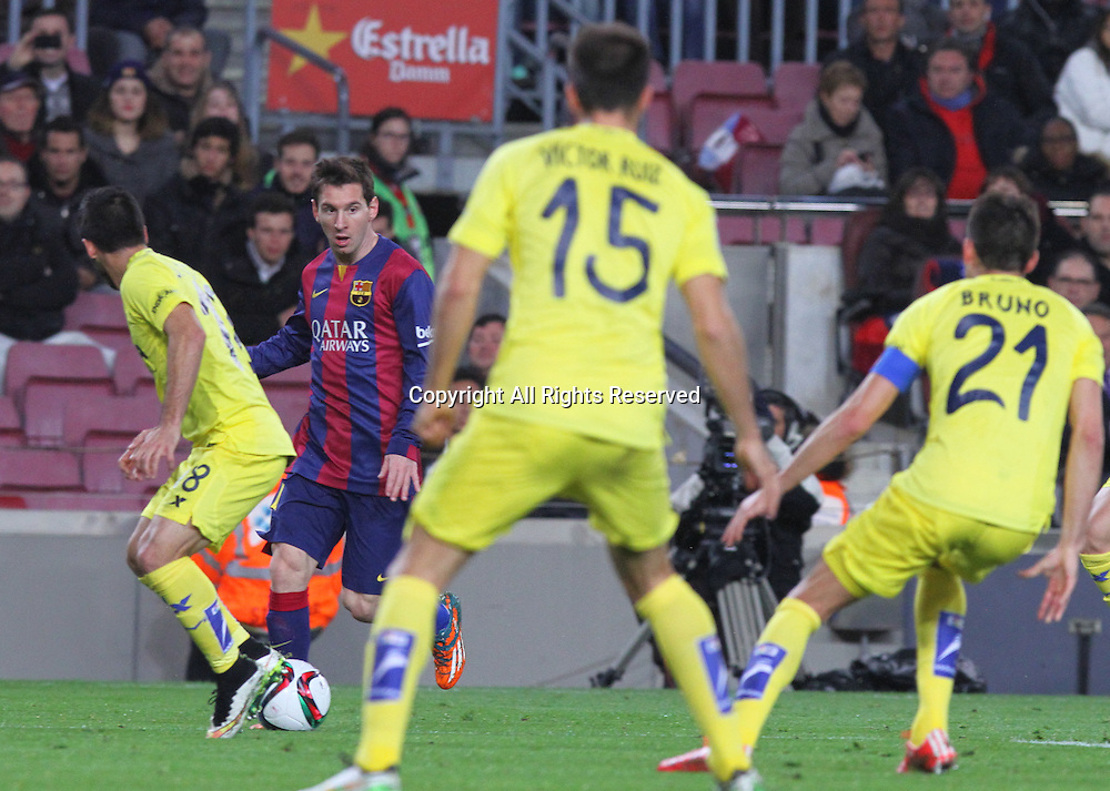 11.02.2015 Barcelona, Spain. Spanish Cup , Semi-final.  Leo Messi covered by 3 defenders during game between FC Barcelona against Villareal at Camp Nou