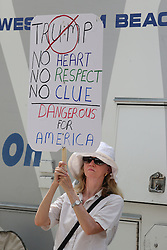 Diana Sita Rogers of Daytona Beach protests outside the Ocean Center before Republican Presidential candidate Donald Trump holds a rally Wednesday, Aug. 3, 2016 in Daytona Beach, FL, USA. Photo by Red Huber/Orlando Sentinel/TNS/BACAPRESS.COM