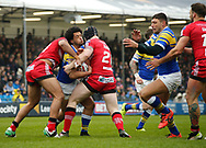 Josh Walters (C) of Leeds Rhinos tackled by Daniel Murray (R) of Salford Red Devils during the Betfred Super League match at Emerald Headingley Stadium, Leeds<br /> Picture by Stephen Gaunt/Focus Images Ltd +447904 833202<br /> 02/04/2018