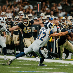 Aug 30, 2018; New Orleans, LA, USA; New Orleans Saints wide receiver Tre'Quan Smith (10) breaks a tackle by Los Angeles Rams safety Nate Holley (42) during the first half of a preseason game at the Mercedes-Benz Superdome. Mandatory Credit: Derick E. Hingle-USA TODAY Sports