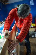 Taro Tamai works on a blank in the shop behind his Gentemstick showroom in Niseko, Hokkaido, Japan.