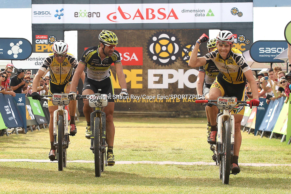Jaroslav Kulhavy of Investec-Songo-Specialized (Far right) celebrates as his partner Christoph Sauser of Investec-Songo-Specialized (Far Left) crosses the line ahead of Kristian Hynek of Topeak Ergon (unsighted) to complete the stage victory as Alban Lakata of Topeak Ergon (2nd left) looks on during stage 6 of the 2015 Absa Cape Epic Mountain Bike stage race from the Cape Peninsula University of Technology in Wellington, South Africa on the 21 March 2015<br /> <br /> Photo by Shaun Roy/Cape Epic/SPORTZPICS<br /> <br /> PLEASE ENSURE THE APPROPRIATE CREDIT IS GIVEN TO THE PHOTOGRAPHER AND SPORTZPICS ALONG WITH THE ABSA CAPE EPIC