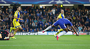 Willian gets taken down by Predrag Rajković  to be awarded a penalty early on in the game during the Champions League match between Chelsea and Maccabi Tel Aviv at Stamford Bridge, London, England on 16 September 2015. Photo by Andy Walter.