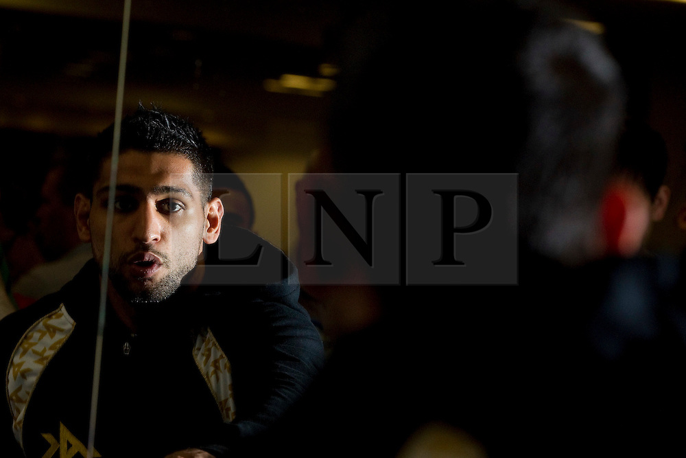 © Licensed to London News Pictures. 30/05/2012. Bolton, UK. Amir Khan holds a workout photocall in Bolton ahead of his stint as an Olympic torchbearer on 31st May. He works out in front of a mirror. Photo credit : Joel Goodman/LNP