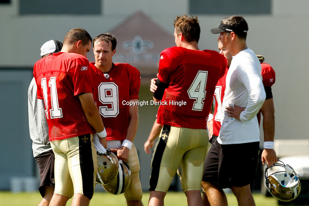 July 31, 2010; Metairie, LA, USA; New Orleans Saints quarterback Drew Brees (9) talks with quarterbacks Patrick Ramsey (11), Chase Daniel (10) and Sean Canfield (4) during a training camp practice at the New Orleans Saints practice facility. Mandatory Credit: Derick E. Hingle