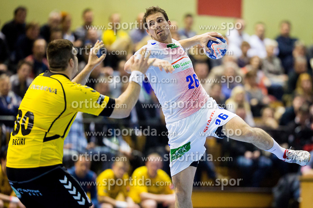 Kristian Beciri of Gorenje vs Adrian Pfahl of HSV Hamburg during handball match between RK Gorenje Velenje and HSV Hamburg (GER) in 8th Round of EHF Champions League 2014 on February 5, 2014 in Rdeca Dvorana, Velenje, Slovenia. Photo by Vid Ponikvar / Sportida