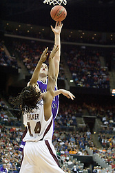 Holy Cross Crusaders center Tim Clifford (00) shoots over Southern Illinois Salukis forward Randal Falker (14).  The #4 seed Southern Illinois Salukis defeated the #13 seed Holy Cross Crusaders 61-51  in the first round of the Men's NCAA Tournament in Columbus, OH on March 16, 2007.