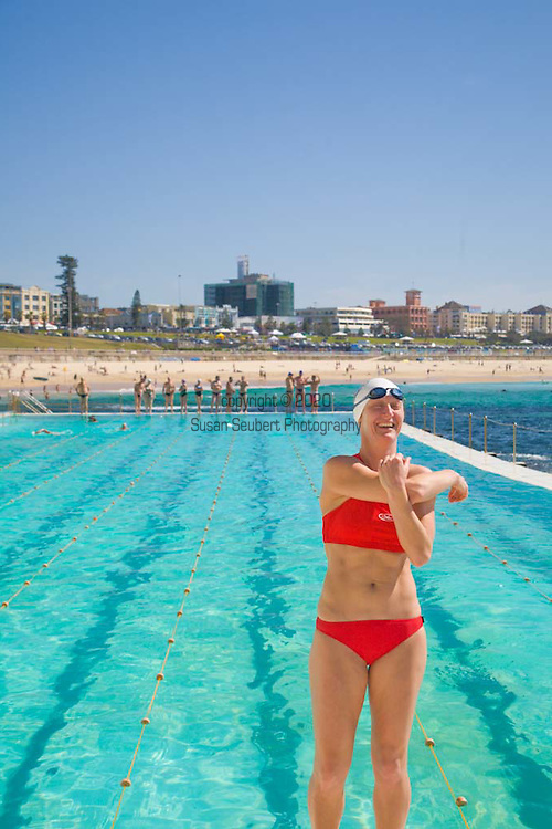 The Icebergs Swim Club swimming during off season with other community swimming club members at the historic Bondi Baths, a saltwater swimming pool. Club member streches before her swim.