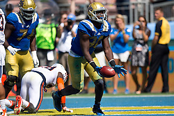 PASADENA, CA - SEPTEMBER 05:  Linebacker Myles Jack #30 of the UCLA Bruins scores a touchdown against the Virginia Cavaliers during the third quarter at the Rose Bowl on September 5, 2015 in Pasadena, California. The UCLA Bruins defeated the Virginia Cavaliers 34-16.   (Photo by Jason O. Watson/Getty Images) *** Local Caption *** Myles Jack