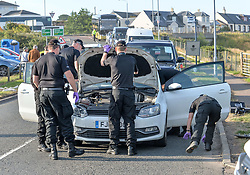 Pictured: Police searched all vehicles near the hotel.<br /> <br /> Protesters gathered amid tight security at the Trump Turnberry resort, where President Trump and his wife Melania are staying on their trip to Scotland.<br /> <br /> &copy; Dave Johnston / EEm