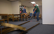 Sean Sullivan, right, of Dayton Ohio, plays mini golf with his son Davis Sullivan in Alden Library during Dad's Weekend on November 5, 2016.