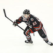 Colton Saucerman #23 of the Northeastern Huskies on the ice during The Beanpot Championship Game at TD Garden on February 10, 2014 in Boston, Massachusetts. (Photo by Elan Kawesch)