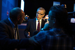 © Licensed to London News Pictures . 01/10/2013 . Manchester , UK . The Education Secretary , MICHAEL GOVE , is interviewed as he leaves the stage after addressing the conference this afternoon (Tuesday 1st October 2013) . Day 3 of the Conservative Party Conference 2013 at Manchester Central . Photo credit : Joel Goodman/LNP