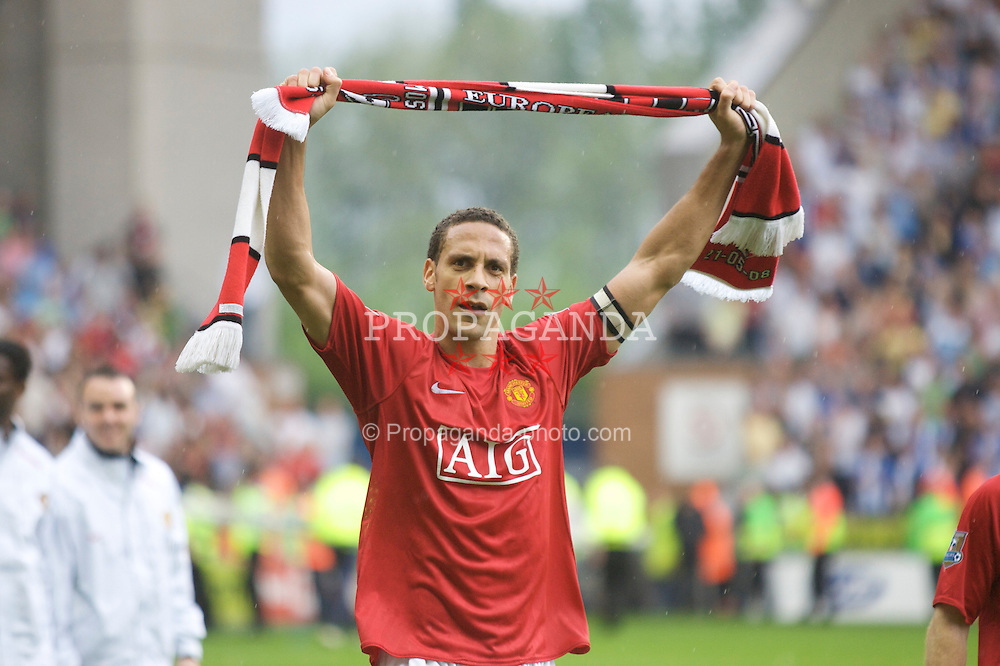 WIGAN, ENGLAND - Sunday, May 11, 2008: Manchester United's Rio Ferdinand celebrates as his side beat Wigan Athletic 2-0 to win the Premier League for the 10th time during the final Premiership match of the season at the JJB Stadium. (Photo by David Rawcliffe/Propaganda)