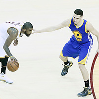 08 June 2016: Golden State Warriors guard Klay Thompson (11) defends on Cleveland Cavaliers guard Kyrie Irving (2) during the Cleveland Cavaliers 120-90 victory over the Golden State Warriors, during Game Three of the 2016 NBA Finals at the Quicken Loans Arena, Cleveland, Ohio, USA.