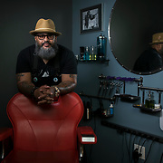"Reggie ""Hollywood the Barber"" Blagmon, in his studio space in Laurel, MD, on Monday, June 18, 2018. He's been a barber for 29 years, inspired by his father's style. His used to be a singer in the '70's for R&B groups, The Stridels and later, The Choice Four who had a few hits and once performed on Soul Train. John Boal Photography"