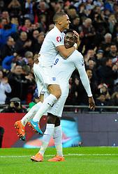 Danny Welbeck of England (Arsenal) celebrates his second goal with Kieran Gibbs (Arsenal)  - Photo mandatory by-line: Joe Meredith/JMP - Mobile: 07966 386802 - 15/11/2014 - SPORT - Football - London - Wembley - England v Slovenia - EURO 2016 Qualifier
