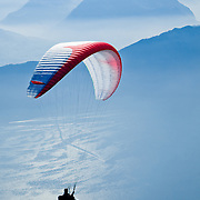 A man paragliding in the Swiss Alps near Mount Rigi.<br />
