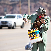 Nicholas Wagner bucket drumming while walking up and down Route 66 Thursday, Feb 28 in Gallup.