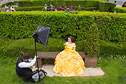 UNITED KINGDOM, London: 26 May 2019 <br /> A cosplayer dressed as Belle from Beauty and the Beast has her picture taken outside London ExCeL during the final day of the MCM London Comic Con. The three day comic convention is being held at London ExCeL from Fri 24th - Sun 26th of May.