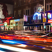 Light trails from passing cars streak down 18th street in the Adams Morgan neighborhood of Washington DC.