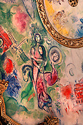 Detail of brightly coloured auditorium ceiling, 1964, by Marc Chagall (1887-1985), Palais Garnier, 1860-75, Paris, France. The ceiling, commissioned by Culture Minister Andre Malraux (1901-76), represents scenes from ballets and operas which might be performed at the Opera House. Picture  by Manuel Cohen.